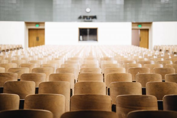 Empty chairs in a graduation ceremony