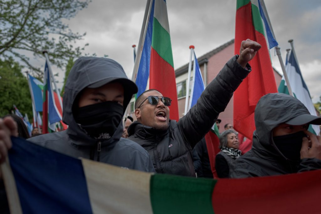 Group of Moluccan protesters holding the national flag